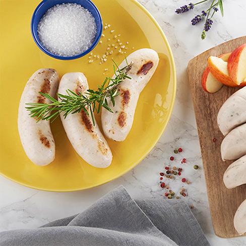 fournisseurs de boudins blancs_boudin sur assiette et planche en bois