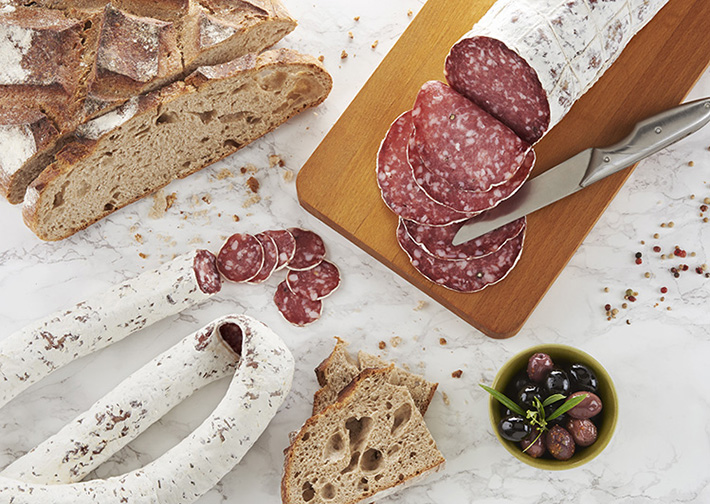 production of saucisson sec_perch sausage with bread and olives